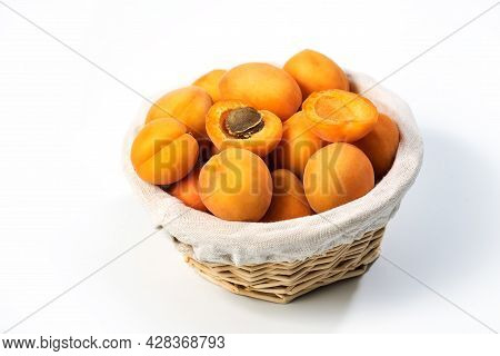 Ripe Apricots On The Table. Orange Apricots Fruits In A Basket. Juicy Apricots Nutrition