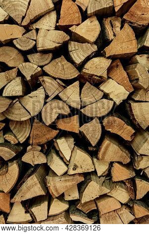 Background Of Dry Chopped Firewood. Firewood Wall. Fresh Wood For Kindling.