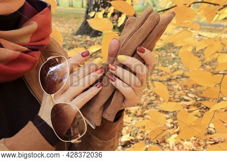 Multicolored Autumn Manicure With Accessories In Hand.
