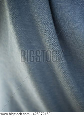 Gray Folded Fabric, Close-up. Fabric Texture. Fabric Folds.