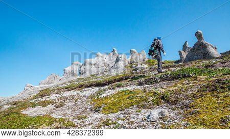 Kamchatka, Russia - July 10, 2018: Hiker Climbing To The Kamchatka Mountains.