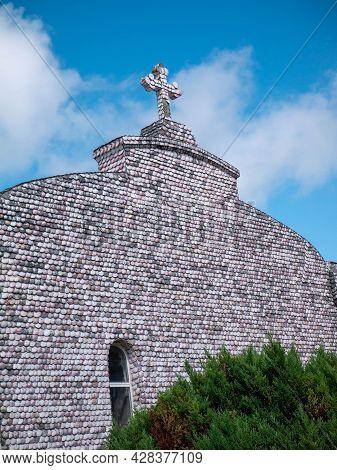La Toja, Spain - July 24, 2021: Facade Of Ermida De San Campio E San Sebastian Shrine Covered With S