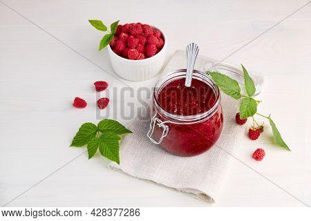 Homemade Raspberry Jam In A Glass Jar On A Linen Napkin. Fresh Raspberry In A Ceramic Bowl. Conserva