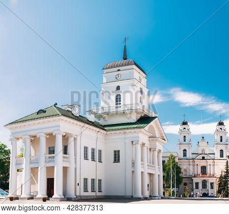 White Building Old City Hall In Minsk, Belarus. Sunny Summer Day