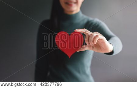 Love, Health Care, Donation And Charity Concept. Close Up Of Smiling Volunteer Woman Holding A Heart