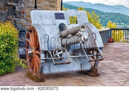 Bergamo, Italy - May 22, 2019: Old Cannon Weapon (obice Da 100-17 M. 14, Skoda, 1914) In The Park Of