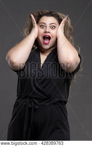 A Beautiful Fat Woman With Long Curly Hair Screams Loudly. A Plump Girl With An Emotion Of Indignati