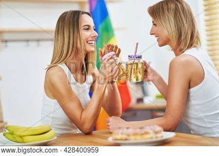 LGBT Lesbian couple love moments in the kitchen happiness concept