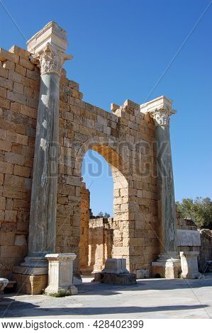 Ruined Archway In The Historic Roman City Of Leptis Magna, Northern Libya.