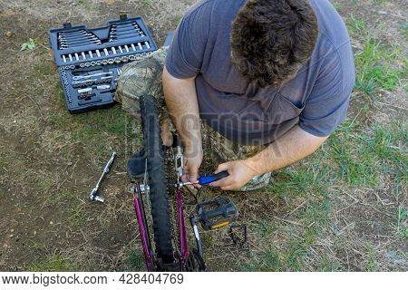 Working Process In Man Repairing Bicycles A Handsome Bike Mechanic