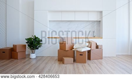 Unpack brown cardboard box in new apartment after relocation to house