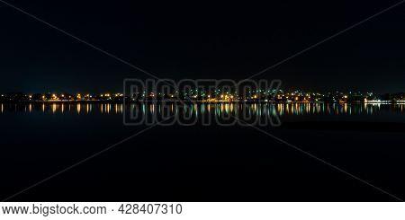 Nighttime Street Lights Reflecting Blurry Streaks Along The Waterfront Of Lake Wendouree In Ballarat