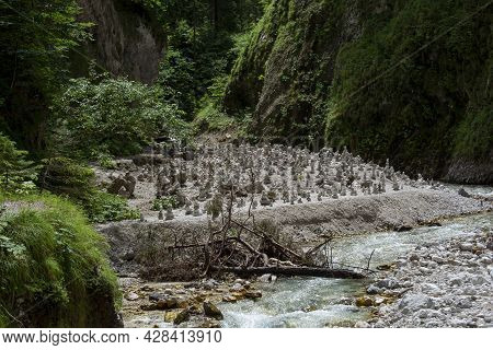 Stone Towers And Piles Of Stones On A River Bank. Stacked Rocks Forming Towers.