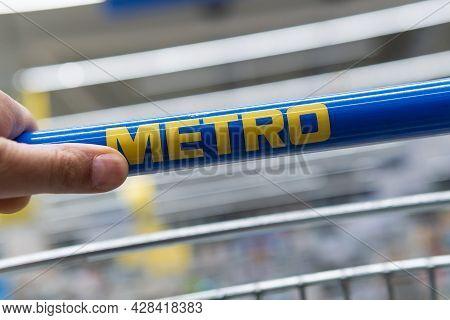 Tyumen, Russia-june 08, 2021: Logo Of The Metro Company. Metro Cash And Carry Is International Playe