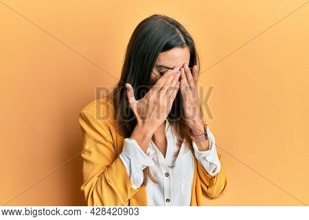 Young beautiful woman wearing business style and glasses rubbing eyes for fatigue and headache, sleepy and tired expression. vision problem