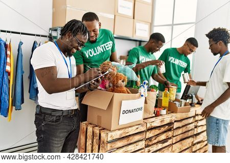 Group of young african american volunteers working at charity center.