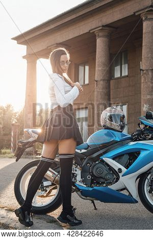 Stylish Schoolgirl With Modern Motorbike Posing In Countrysidestylish Schoolgirl With Modern Motorbi