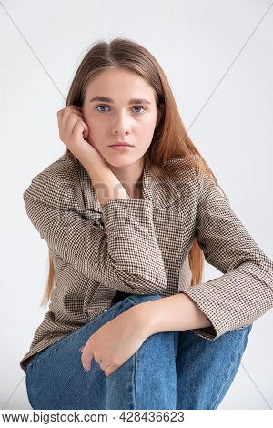 Closeup Portrait Of Young Caucasian Attractive Woman With Long Brown Hair In Blue Jeans And Suit Jac