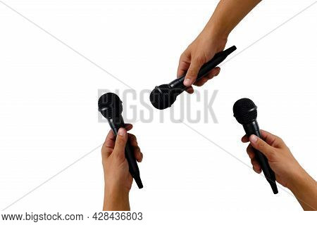 Microphones In Hands On A White Background Of Isolate. Vocal Music And Singing