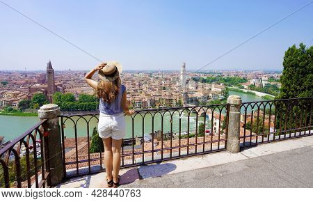 Enjoying Italy. Beautiful Stylish Woman On Terrace Enjoying Cityscape Of Verona, Italy.