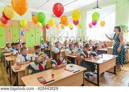 Krasnodar, Russia - September 1, 2020: First-form Schoolchildren In Classroom At School Desks On Hol