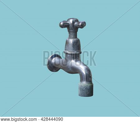 The Hand Crank Faucet Is Made Of Silver Stainless Steel That Looks Old Through Long Use. There Are S