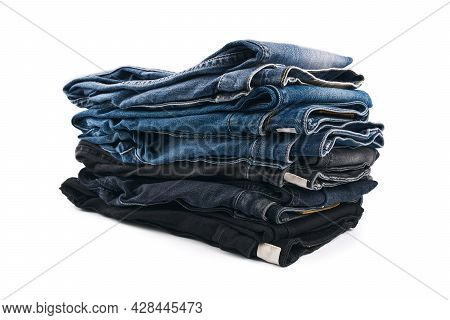 Stack Of Various Shades Of Blue Jeans On White Background Denim Jeans Texture. Denim Background Text