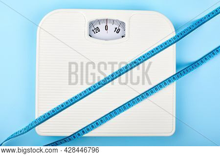 Bathroom Scales And Measuring Tape For Weight Loss Concept. Sport And Diet For Losing Weight. Bathro