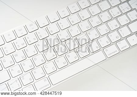Woman Typing On A Keyboard White Wireless Computer Keyboard Isolated On White Background. Russian /