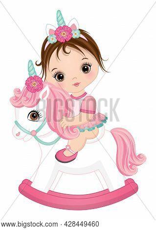 Cute Little Unicorn Baby Girl Riding Rocking Horse. Brunette Baby Girl Wearing Pink Ruffled Dress An