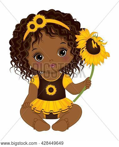 Cute Little Black Baby Girl Wearing Yellow And Brown Dress And Floral Headband. African American Bab