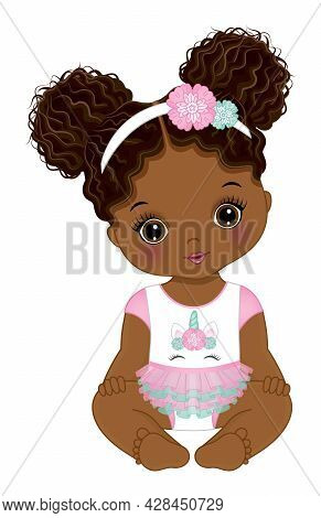 Cute Little Black Baby Girl Wearing Unicorn Dress And Floral Headband. Baby Girl Has Two Buns. Afric