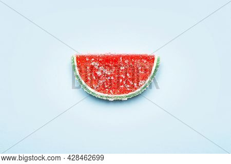 Jelly Candy. One Watermelon Jelly Candy Sprinkled With Sugar On A Blue Background. Watermelon Marmal