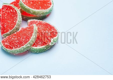 Jelly Candies. Watermelon Jelly Candies Sprinkled With Sugar On A Light Blue Background With Copy Sp