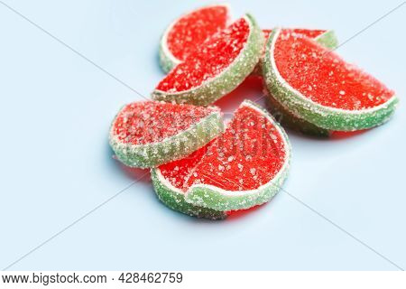 Jelly Candies. Close-up Of Jelly Candies On A Blue Background. Watermelon Marmalade. Selective Soft