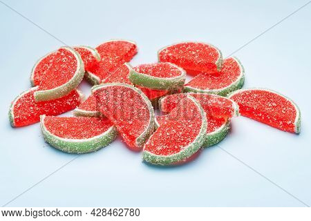 Jelly Candies. Jelly Candies Sprinkled With Sugar On A Blue Background. Watermelon Marmalade. Select