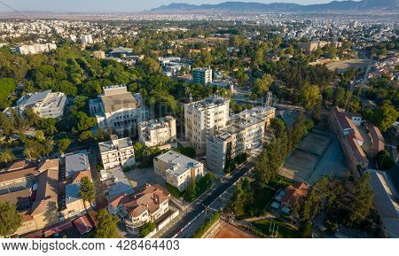 Aerial View Of The Cityscape Of Nicosia, The Capital City Of Cyprus. Drone Panorama Photograph