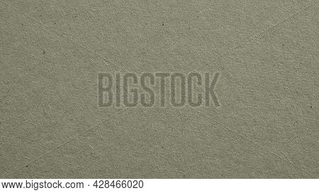 The Surface Of Gray Cardboard. Paper Texture With Cellulose Fibers. Paperboard Wallpaper. Background