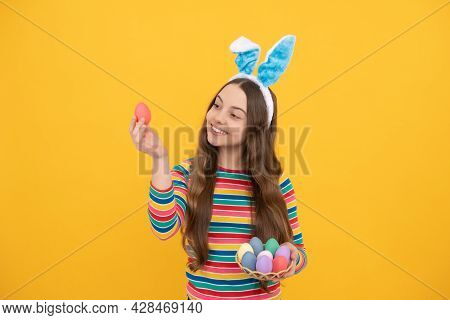 Happy Easter Child Girl In Rabbit Bunny Ears Showing Painted Eggs For Holiday, Easter