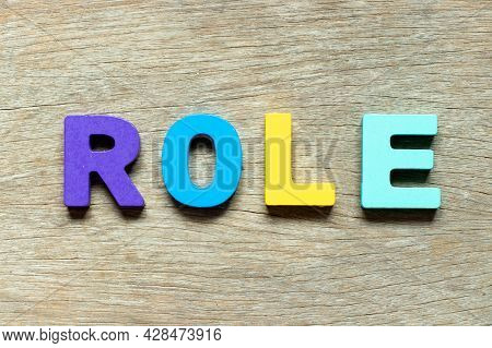 Color Alphabet Letter In Word Role On Wood Background