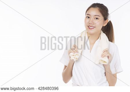 Cheerful Young Woman Wear Bathrobe Holding Towel On Her Neck In Bathroom After Finished Shower Over