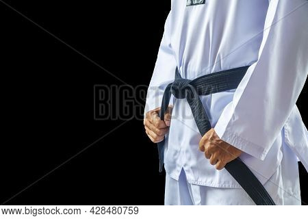 Taekwondo Traditional Man Hand Hold Black-belt On Black Background For Advertising. The Karate Man S