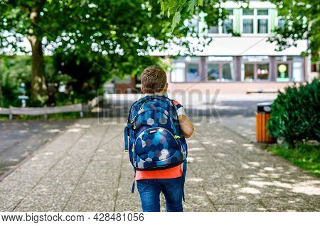 Happy Little Kid Boy With Satchel. Schoolkid On The Way To Middle Or High School. Healthy Adorable C