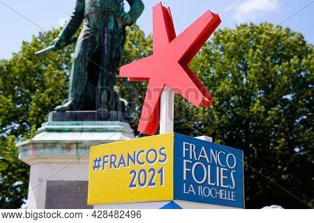 La Rochelle , Aquitaine France - 07 25 2021 : Francofolies La Rochelle Red Star Sign Of French Festi