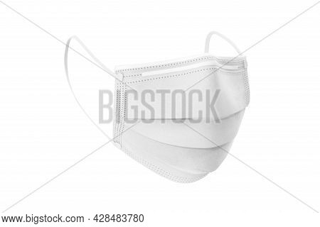 White Protection Face Mask With Ear Straps. Procedure Mask To Cover Mouth And Nose To Protect From V