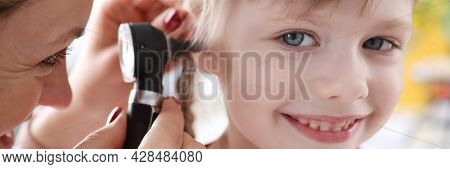 Little Child With Doctor Exam Hearing Deviation