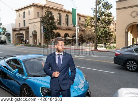 Handsome Bearded Man Businessman In Businesslike Suit Stand By Luxury Car Outdoor, Confidence