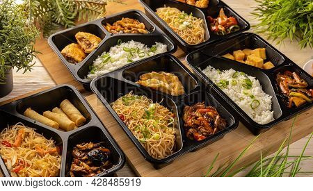Spicy Chinese Take Out Food. Portions Of Asian Food.