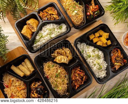 Flat Lay Of Japanese Takeaway Food Packaged In Special Boxes.