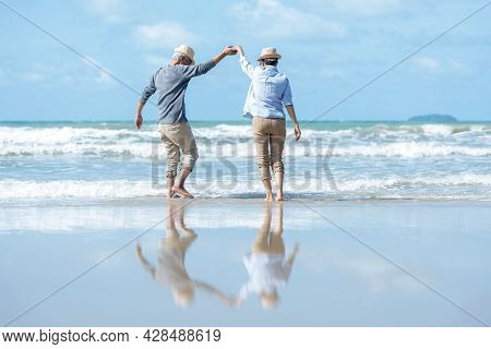 Retirement Travel. Asian Lifestyle Senior Couple Dancing On The Beach Happy And Relax Time.  Tourism